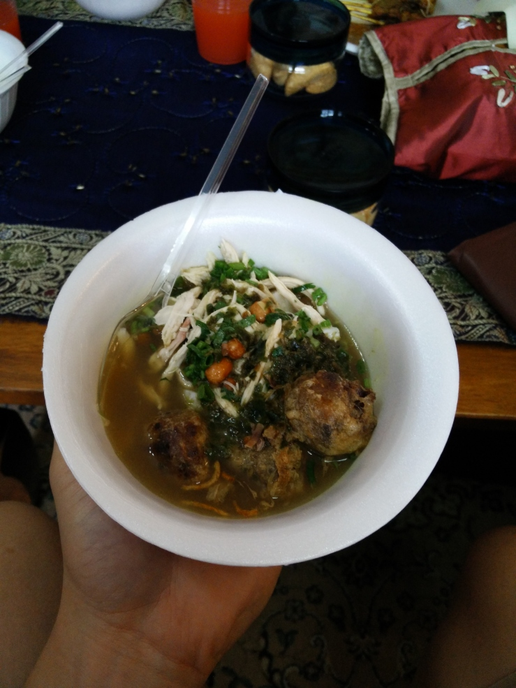 proper soto with sambal hitam, bergedil, and nasi impit